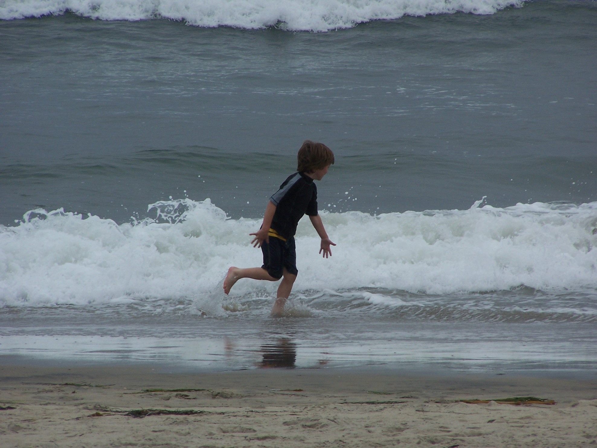 Caden playing in the surf at Oceanside